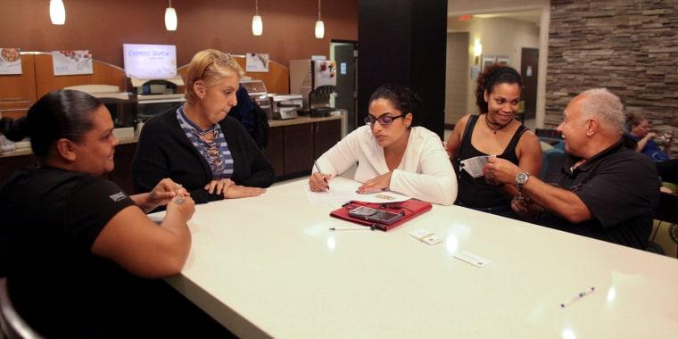 Image: The Wider Image: Displaced Puerto Ricans seek refuge in Florida