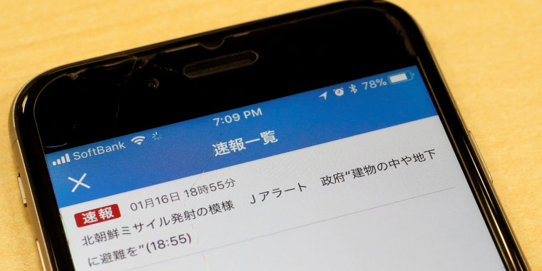 Image: Japan's public broadcaster NHK's false alarm about a North Korean missile launch which was received on a smart phone is pictured in Tokyo