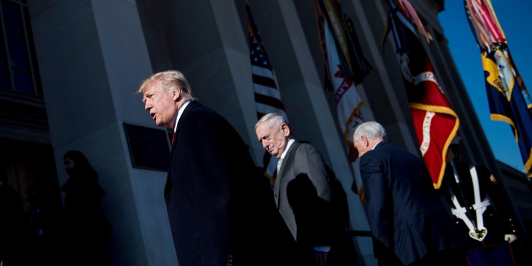 Image: President Donald Trump, Secretary of Defense James Mattis and Vice President Mike Pence walk into the Pentagon for a meeting