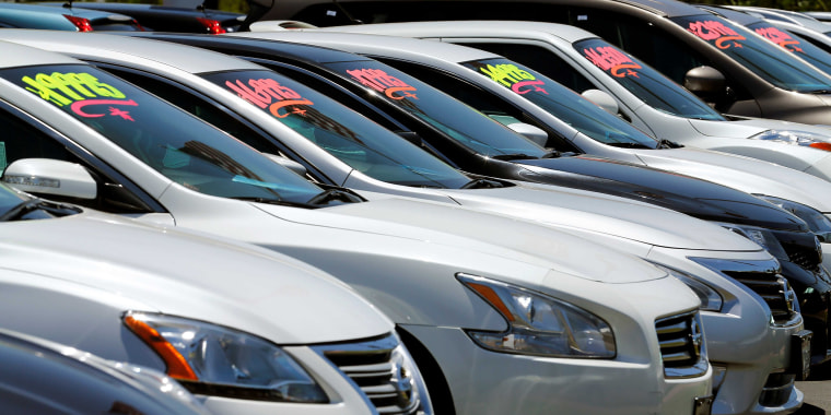 Image: Automobiles are shown for sale at a car dealership in Carlsbad, California