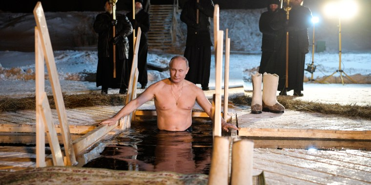 Image: Putin bathes in an ice-cold water on Epiphany