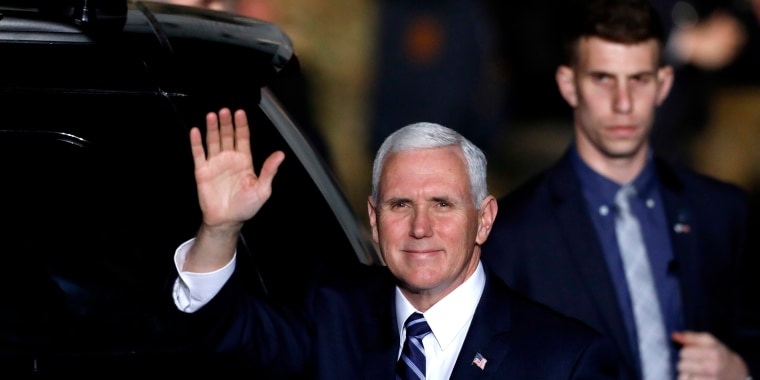 Image: Vice President Mike Pence waves after arriving at Ben Gurion International Airport