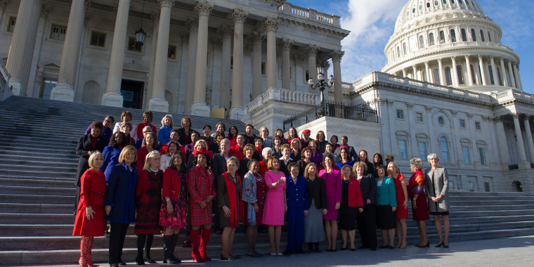 Image: House Minority Leader Nancy Pelosi of Calif. poses with women members of the House