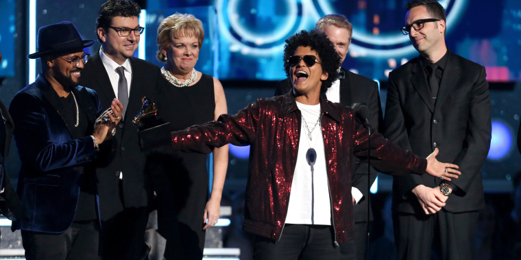Image: Bruno Mars accepts the award for record of the year