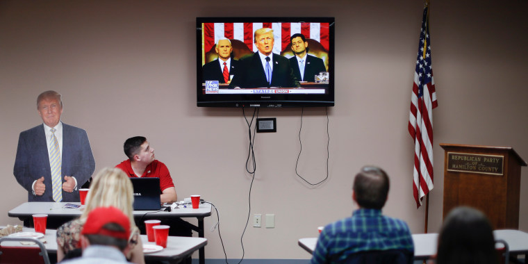 Image: Supporters watch President Donald Trump speak at a State of the Union watch party
