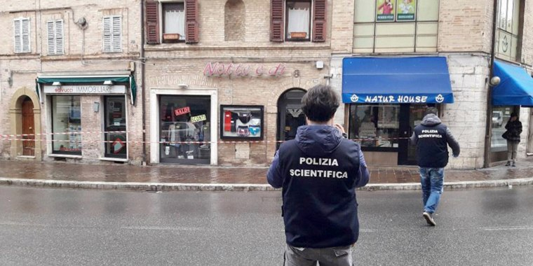 Image: Crime scene investigators work at the scene of crime after a shooting in Macerata, Italy, on Feb. 3, 2018.
