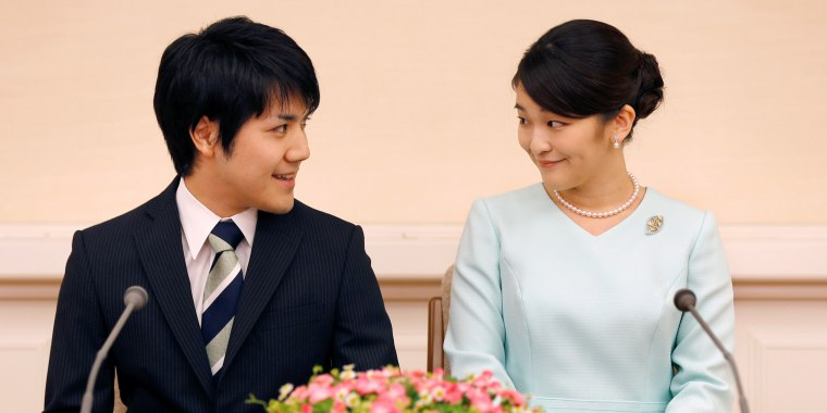 Image: Princess Mako and her fiancee Kei Komuro smile during a press conference to announce their engagement at Akasaka East Residence in Tokyo