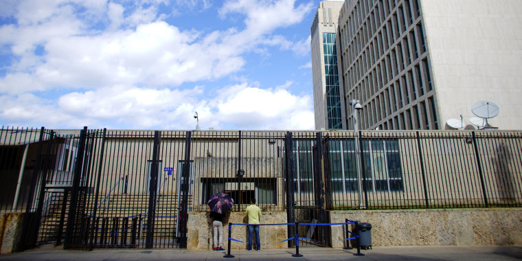 Image: People talk to security officials at the U.S. Embassy in Havana