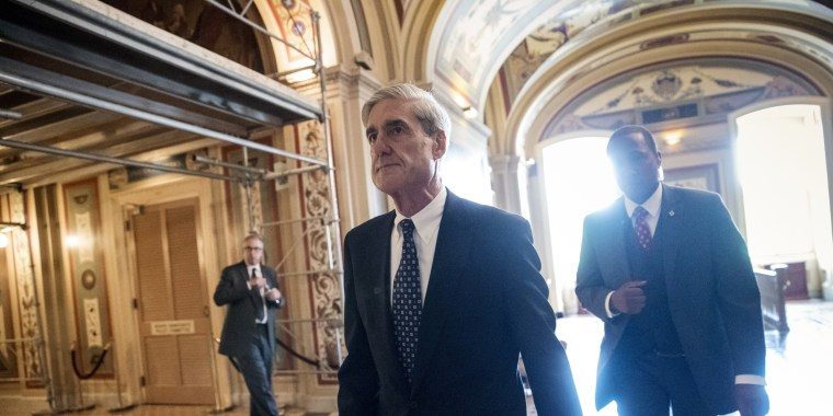 Image: Robert Mueller departs after a closed-door meeting
