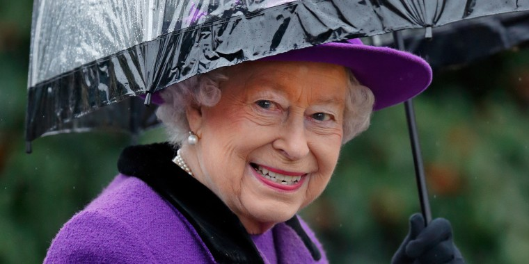 Queen Elizabeth II with umbrellas