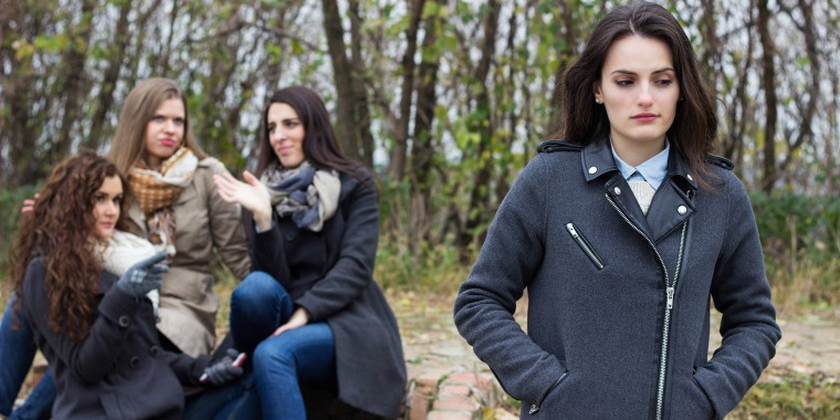 Upset girl with friends gossiping
