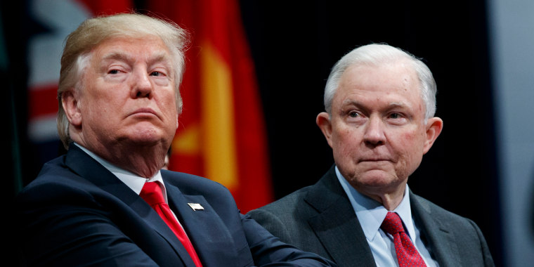 Image: President Donald Trump, left, sits with Attorney General Jeff Session
