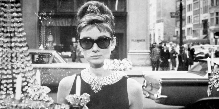 "Hepburn wore Givenchy's designs in ""Breakfast at Tiffany's."""