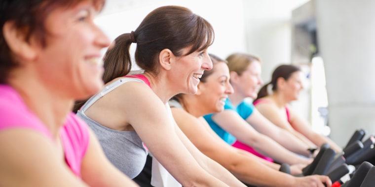 Image: Women riding exercise bikes