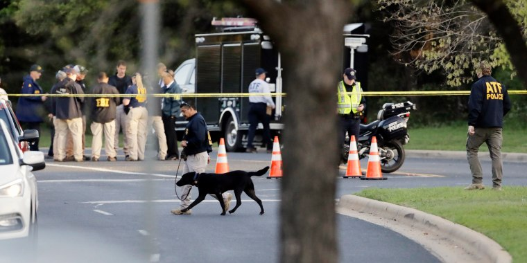 Image: Officials work and stage near the site of Sunday's deadly explosion