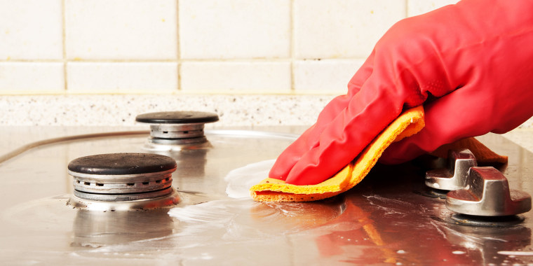 The man cleaning gas stove