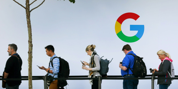 Image: People wait in line to enter a Google product launch