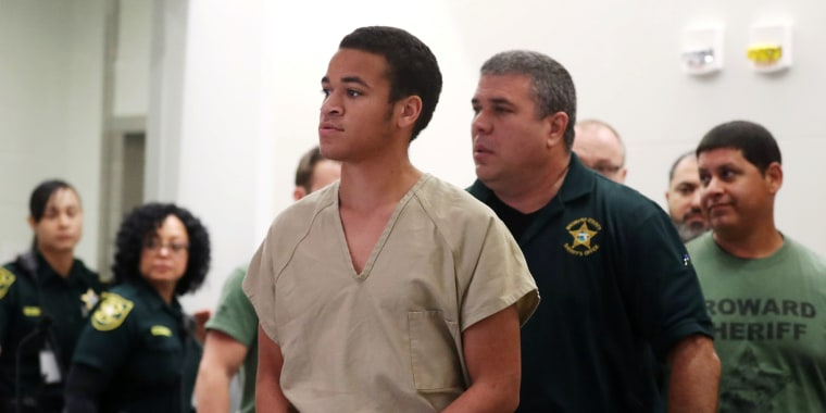 Image: Zachary Cruz, 18, brother of Nikolas Cruz, walks into Broward court for a bond hearing in Fort Lauderdale