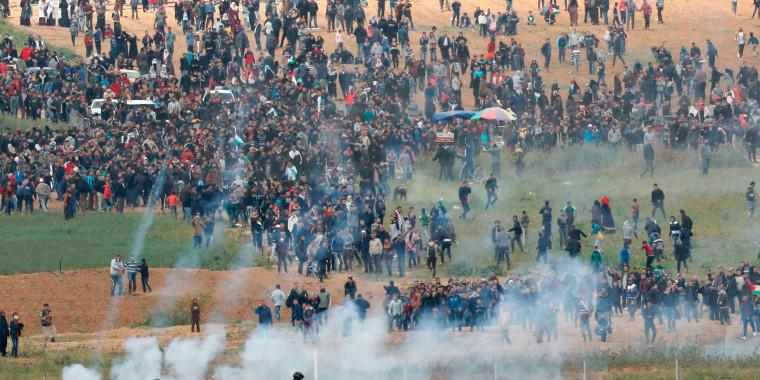 Image: Israeli forces shoot tear gas at Palestinian protesters along the Gaza - Israeli border fence
