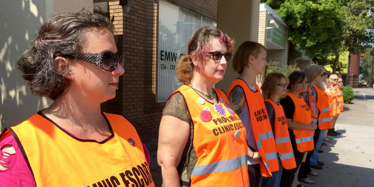 Image: Meg Stern, left, and other escort volunteers line up outside the EMW Women's Surgical Center in Louisville, Kentucky, July 17, 2017.