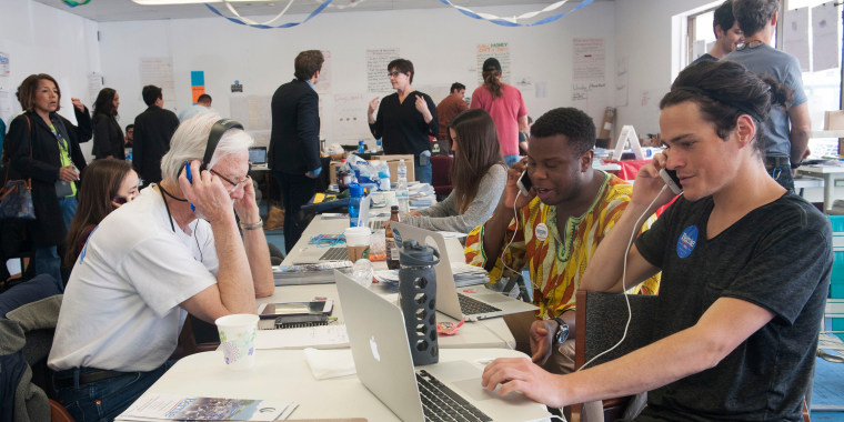 Image: Campaign staffers work at Democratic presidential candidate Senator Bernie Sanders campaign headquarters
