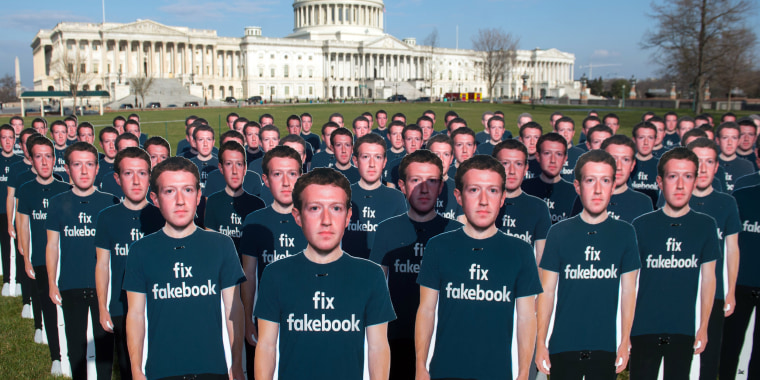 Image: One hundred cardboard cutouts Mark Zuckerberg stand outside the U.S. Capitol