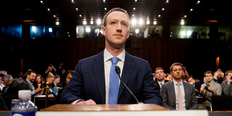 Image: Mark Zuckerberg arrives to testify before a joint hearing