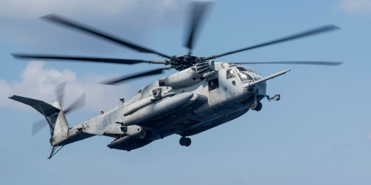 Image: A CH-53 Super Stallion, assigned to the 'Wolfpack' of Marine Heavy Helicopter Squadron (HMH) 466, approaches the flight deck of the amphibious assault ship USS Bonhomme Richard (LHD 6) in the Philippine Sea, on March 23, 2018.
