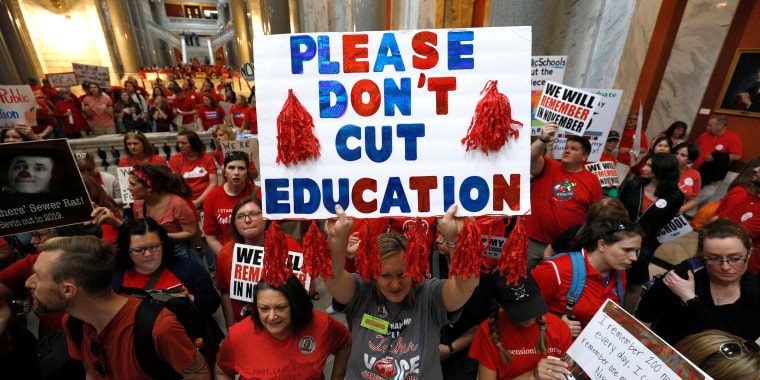 """Image: Kentucky Public school teachers protest outside the Kentucky House Chamber as they rally for a """"day of action"""""""