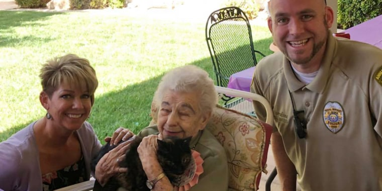 Lillian Grant smiles with Joseph Harradine, Debbie Presland and her new cat, Marley.