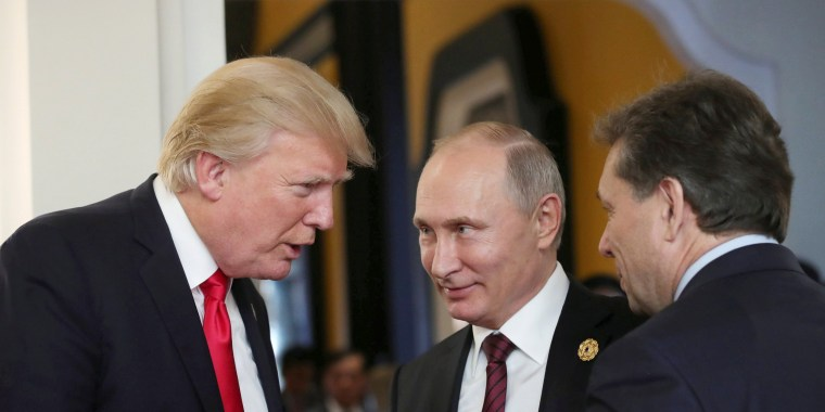 Image: Trump and Putin talk during a break in a session of the APEC summit in Danang, Vietnam on Nov. 11, 2017.