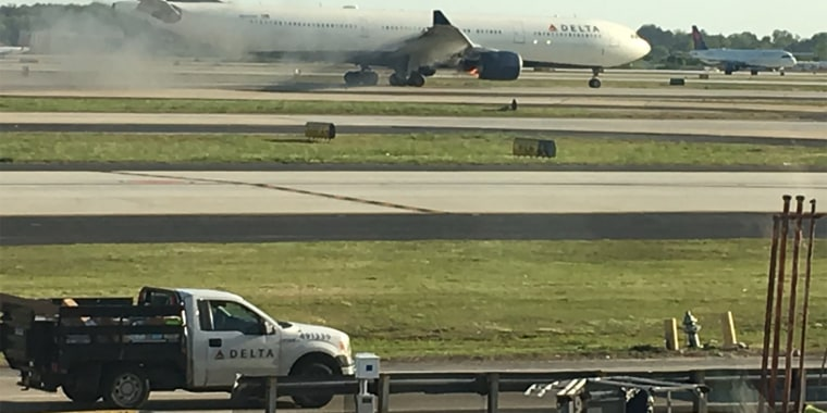 Image: Delta Airlines flight 30 on fire after landing safely.