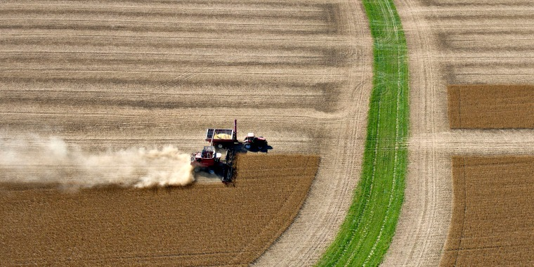 Image: Soybeans are harvested on a farm near Peru, Illinois
