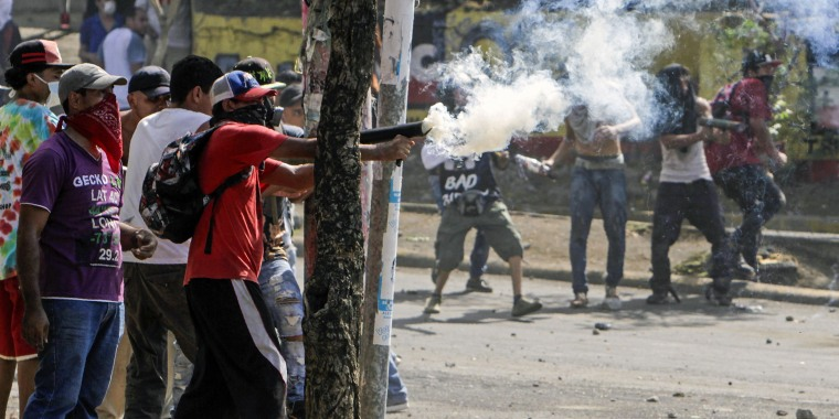 Image: Students clash with riot police agents close to Nicaragua's Technical College during protests in Managua
