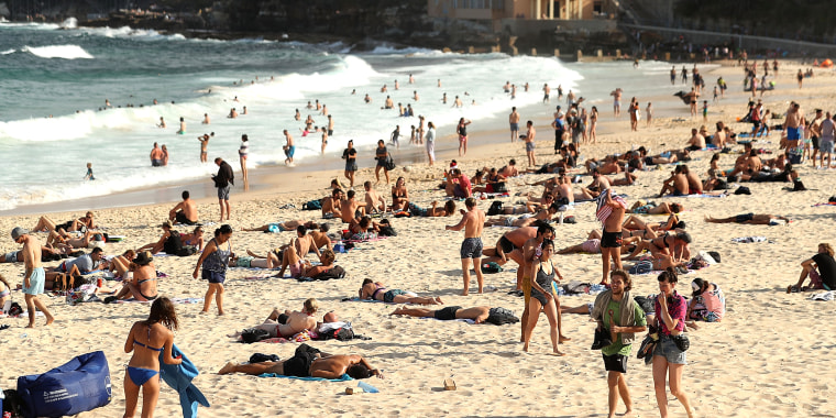 Image: People sunbathe at Coogee beach on Dec. 14, 2017 in Sydney, Australia.
