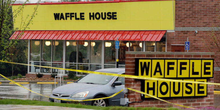 Image: Police tape blocks off a Waffle House restaurant