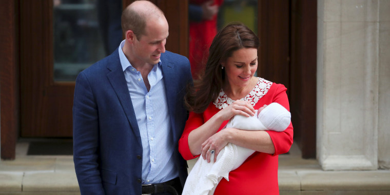 Image: Britain's Catherine, the Duchess of Cambridge and Prince William leave the Lindo Wing of St Mary's Hospital with their new baby boy in London