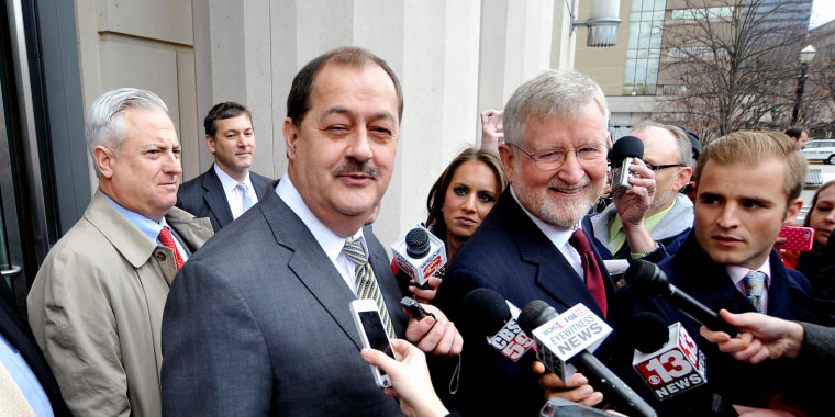 Image: Former Massey Energy Chief Executive Don Blankenship and his attorney Bill Taylor are met by media outside the Robert C. Byrd U.S. Courthouse in Charleston West Virginia