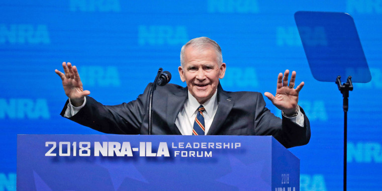 Image: US Marine Corps Lt. Col. (Ret.) Oliver North speaks at an NRA convention in Dallas