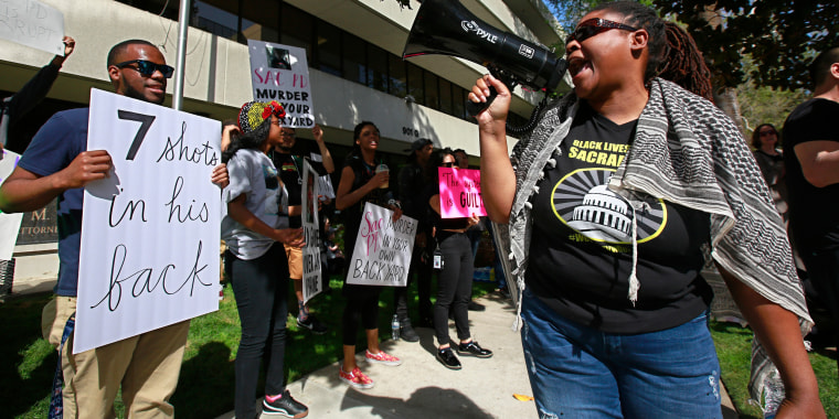 Protesters call for the indictment of police officers involved in the shooting death of Stephon Clark in Sacramento, California.