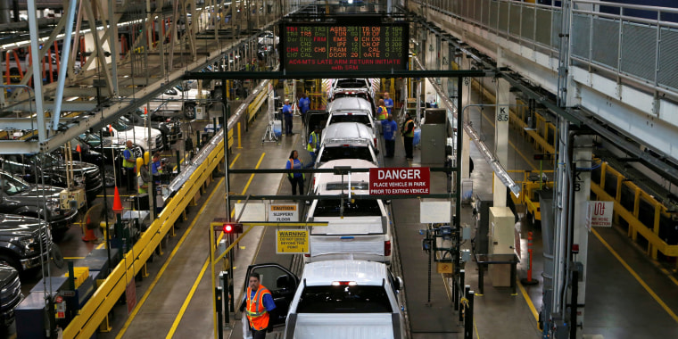 Image: Ford 2015 F-150 pickup trucks move down the final inspection line at the Ford Rouge Center in Dearborn