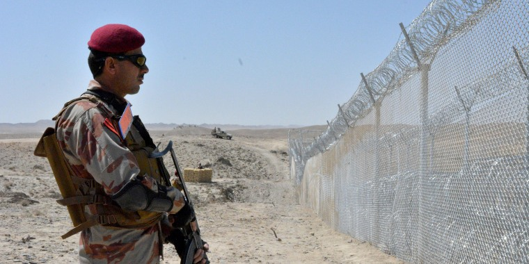 Image: A Pakistani army soldier stands guard along with border fence at the Pakistan-Afghanistan border near the Punjpai area of Quetta in Balochistan on May 8, 2018.