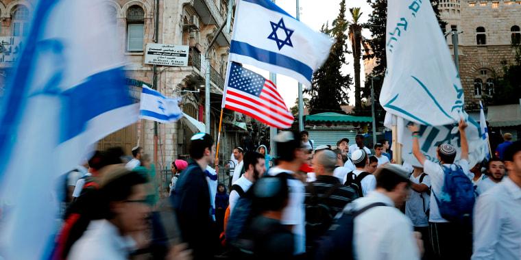 Image: Demonstrators wave U.S. and Israeli national flags in Jerusalem's Old City