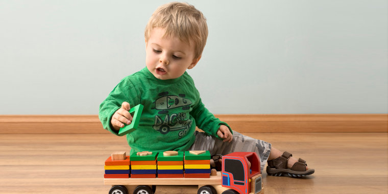 Image: Todler playing with toy