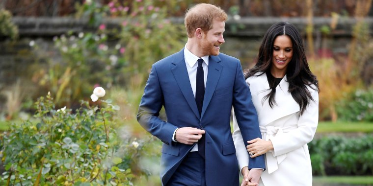 Image: Britain's Prince Harry poses with Meghan Markle in the Sunken Garden of Kensington Palace, London
