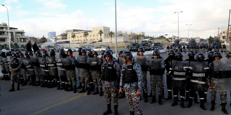 Image: Jordanian police stand guard near at the U.S. embassy in Amman