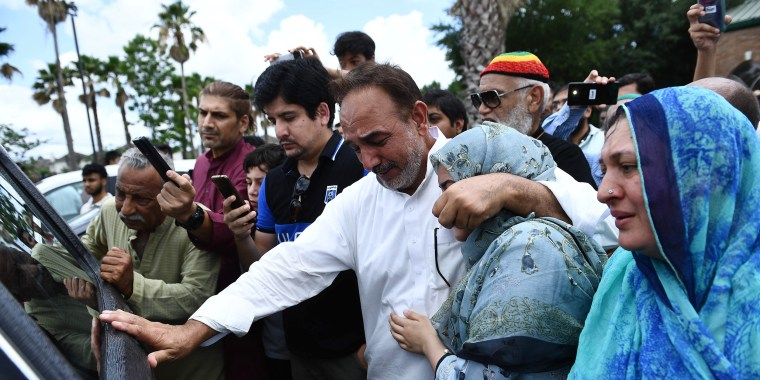 Image: Nasir Shenwari, center, holding his daughter Aunza, grieves as the casket of Santa Fe High School shooting victim Sabika Sheikh leaves