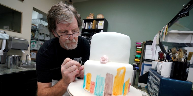 Image: Baker Jack Phillips decorates a cake in his Masterpiece Cakeshop in Lakewood