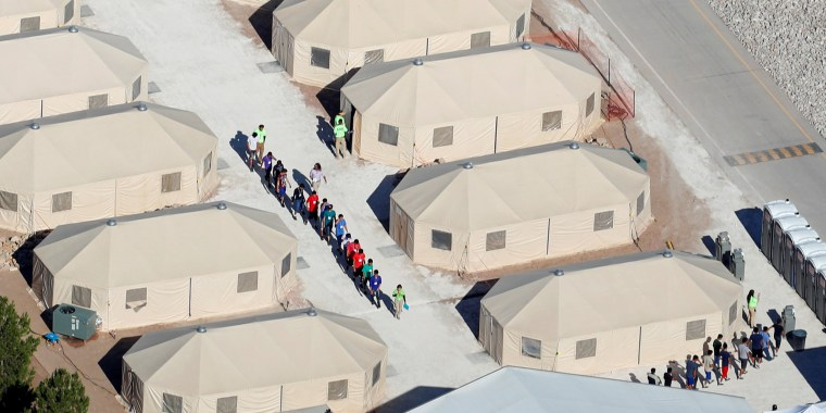 "Image: Immigrant children, many of whom have been separated from their parents under a new ""zero tolerance"" policy by the Trump administration, are being housed in tents next two the Mexican border in Tornillo, Texas"
