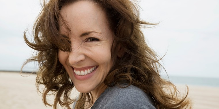 Portrait enthusiastic brunette woman at beach